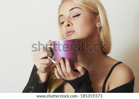 Beautiful blond woman drinking Coffee. Cup of tea. Hot drink Delicious - stock photo