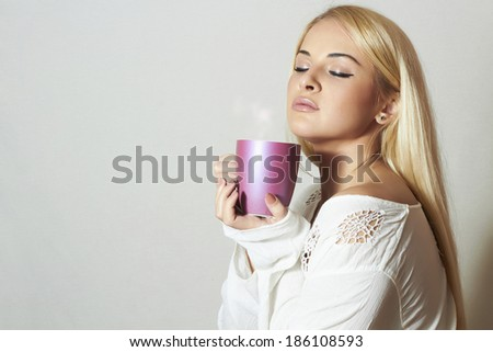 Beautiful blond woman drinking Coffee. Cup of tea. Hot drink. Sweet girl in the Morning - stock photo