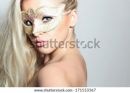 Beautiful Blond Woman in a Carnival Mask.Masquerade. Sexy Girl. Lovely - stock photo