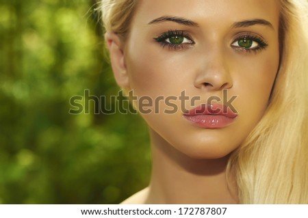Beautiful Blond Woman in Forest. Summer Sunlight.Beauty Girl. Make-up - stock photo