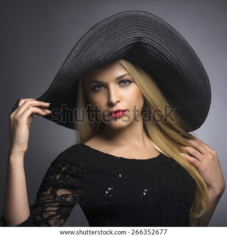 Beautiful Blond Woman in Hat. Fashionable Lady. Elegance Beauty Girl - stock photo