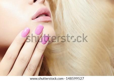 beautiful blond woman.lips,nails and hair - stock photo