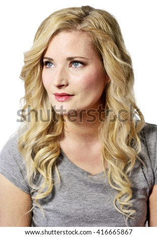 Beautiful blond woman looking up. Positive Emotions. Young woman with copy space, isolated on white background. - stock photo