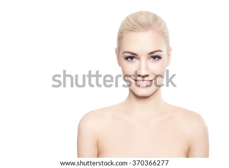 Beautiful blond woman with cotton flowers-skin care concept - stock photo