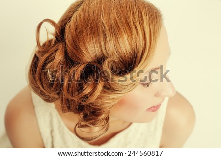 Beautiful blond woman with curly hairstylem studio shot  - stock photo