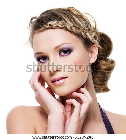Beautiful blond woman with fashion hairstyle with element of pigtail- on a white - stock photo