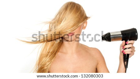 Beautiful blond woman with fluttering hair covered her face - stock photo