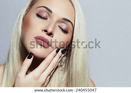 Beautiful blond Woman with professional make-up. Sexy Beauty Girl. Nail Beauty salon. Shellac manicure - stock photo