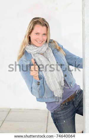 Beautiful blond woman with thumb up - stock photo