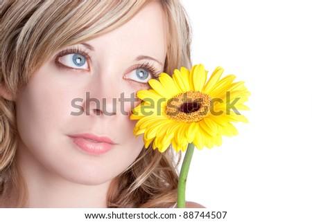 Beautiful blond yellow flower woman - stock photo