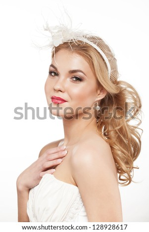 Beautiful blonde bride with beauty wedding coiffure - stock photo