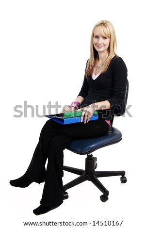 Beautiful blonde businesswoman holding green and blue files while sitting on a secretary's chair. Isolated on white background - stock photo