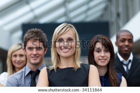 Beautiful blonde businesswoman leading her team - stock photo