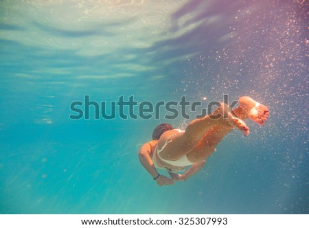 beautiful blonde girl dive underwater - stock photo