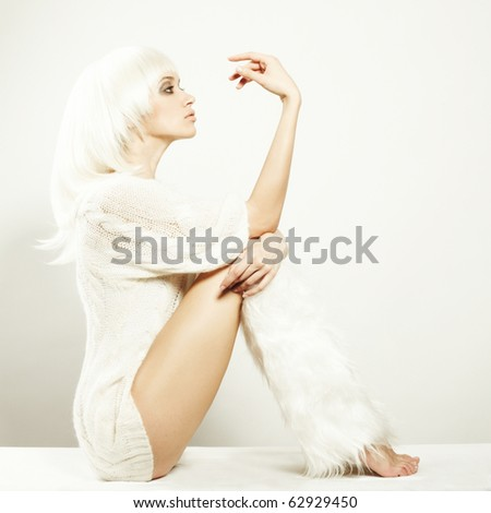 beautiful blonde girl fashion wind hair over white - stock photo