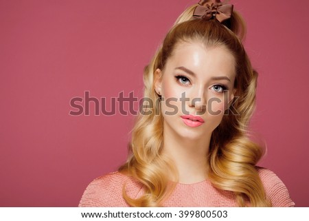 Beautiful Blonde Girl. Healthy Long Curly Hair.Pink dress - stock photo