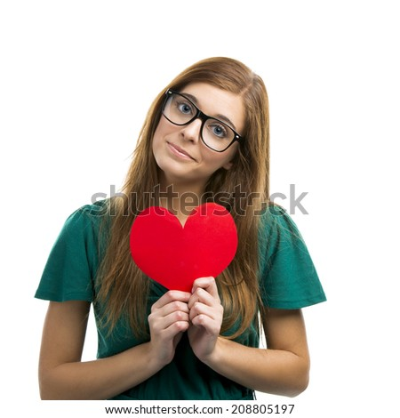 Beautiful blonde girl holding a hearth - stock photo