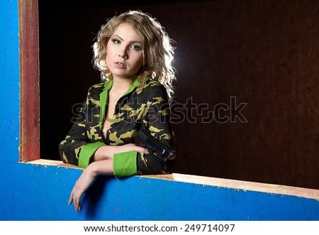 Beautiful blonde girl in military khaki shirt - stock photo