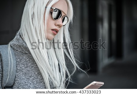 Beautiful blonde girl in posing outdoors - stock photo