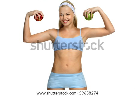 Beautiful blonde girl in sport cloth holding two apples - stock photo