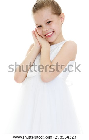 Beautiful blonde girl of school age in a long white airy dress has a lovely smile , close-up-Isolated on white background - stock photo
