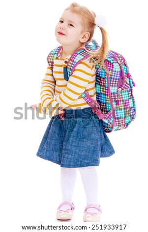 beautiful blonde girl schoolgirl with satchel up behindIsolated on white background, Lotus Children's Center. - stock photo