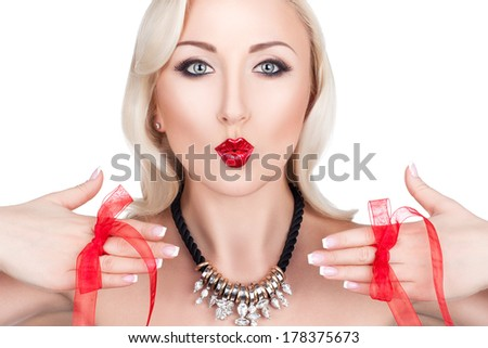 Beautiful blonde girl showing a kiss and hands with French manicure on which red bows. - stock photo