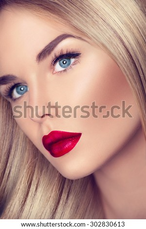 Beautiful Blonde Girl with Healthy blond Hair and perfect make up, beautiful skin. eye makeup, long eyelashes. Closeup of Beauty Woman face make up. Bright make-up with sexy red lips and perfect skin - stock photo