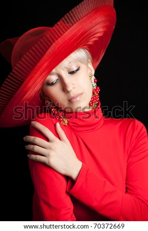 beautiful blonde in a red hat on a black background - stock photo