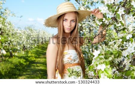 beautiful blonde in a spring garden - stock photo