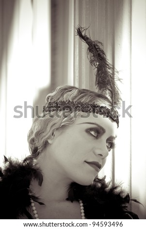 "Beautiful blonde in 1920s era of fashion The Flapper"" - stock photo"