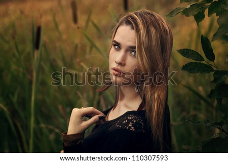 beautiful blonde in the park - stock photo
