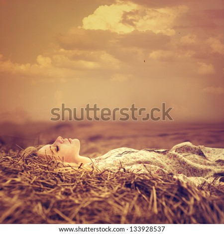 beautiful blonde is in a magical place in the meadow - stock photo