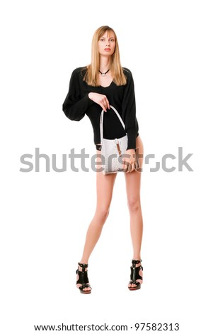 Beautiful blonde lady with the white purse - stock photo
