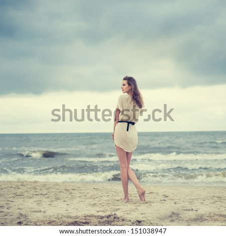 beautiful blonde on the ocean - stock photo
