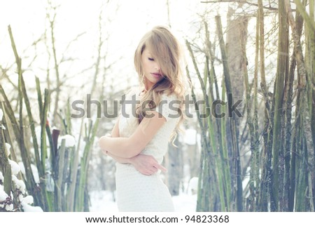 beautiful blonde posing outdoors in winter - stock photo