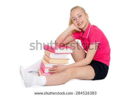 beautiful blonde schoolgirl hugging a stack of books- isolated on white background - stock photo