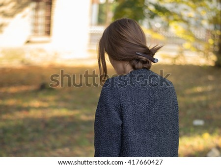 beautiful blonde walks in the park in spring - stock photo