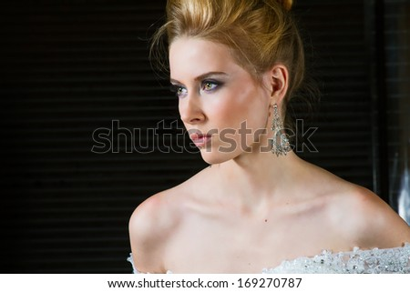 Beautiful Blonde With Long Hair Posing on Her Wedding Day - stock photo