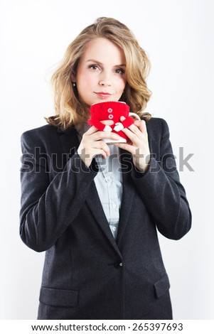 Beautiful blonde with red cup in his hands. Business woman. Closed for lunch. Tea party. Isolated on white. Portrait of a beautiful blonde - stock photo