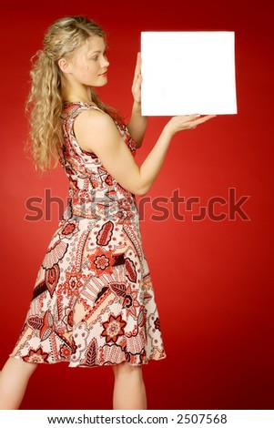 beautiful blonde with white leaf for text - stock photo