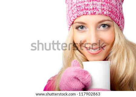 beautiful blonde woman holding white cup of drink - stock photo