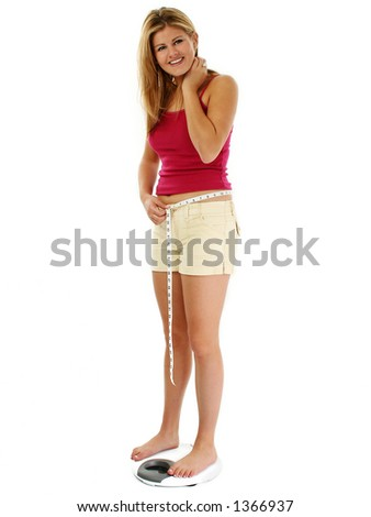 Beautiful blonde woman on scale, measures her weight loss progress - stock photo