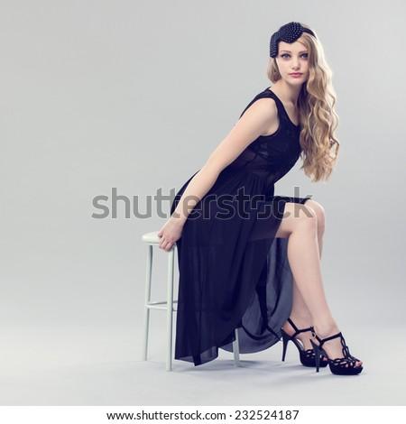 Beautiful Blonde Woman. Retro Fashion Image. - stock photo