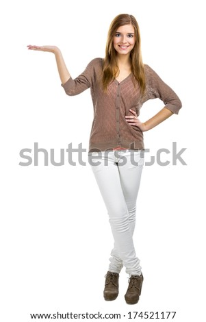 Beautiful blonde woman showing something with her hand, isolated over a white background - stock photo