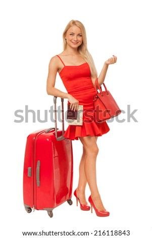 beautiful blonde woman wearing red dress holding big bag, documents and suitcase isolated on white  - stock photo