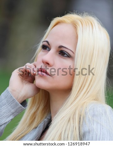 Beautiful blonde woman with long golden hair - stock photo