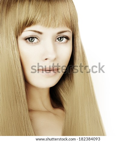 Beautiful blonde woman with long hair and makeup, fashion portrait - stock photo