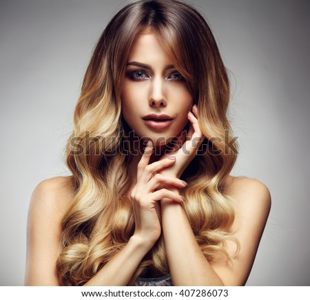 Beautiful blonde woman with long, healthy , straight and shiny hair. Hairstyle loose hair  - stock photo