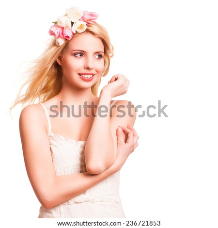 beautiful blonde woman with tulip hair decoration on isolated background - stock photo